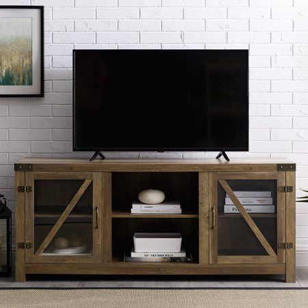 Most Recently Released Tv Stands With Sliding Barn Door Console In Rustic Oak In Manor Park 58 Inch Glass Barn Door Tv Stand With Side (View 15 of 15)